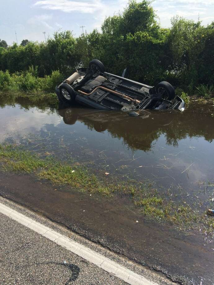 Lt. Shawn Sayers and Deputy Phil Crowell were traveling in the 5500 block of Katy Hockley Cut-Off Road on May 27 when they observed a black car overturned and submerged in the ditch. Photo: Fort Bend County Precinct 3 Constable's Office