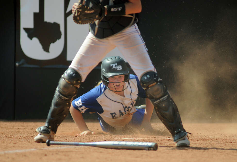 Barbers Hill junior shortstop Miranda Wiggins scores in the bottom of the 5th inning against Ennis catcher Kinsey Skroh during their Class 4A semifinal matchup at the 2014 UIL Softball State Championsips at McCombs Field in Austin on Friday. Photo: Jerry Baker, For The Chronicle