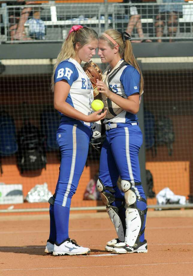 The Barbers Hill battery of twins and seniors Randi Rupp, left, the pitcher, and catcher Sara, share a moment on the pitching rubber before the start of their class 4A semifinal matchup versus Ennis at the 2014 UIL Softball State Championsips at McCombs Field in Austin on Friday. Photo: Jerry Baker, For The Chronicle