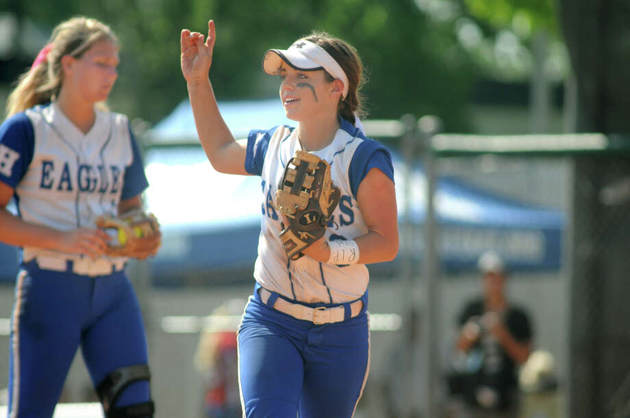 Barbers Hill senior third baseman Sarah Barker signals two outs against Ennis in the top of the 4th inning in their Class 4A semifinal matchup at the 2014 UIL Softball State Championsips at McCombs Field in Austin on Friday. Photo: Jerry Baker, For The Chronicle