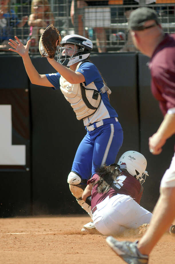 Barbers Hill senior catcher Sara Rupp makes a play on Ennis baserunner Mo Monreal in the top of the sixth inning of their Class 4A semifinal matchup at the 2014 UIL Softball State Championsips at McCombs Field in Austin on Friday. Photo: Jerry Baker, For The Chronicle