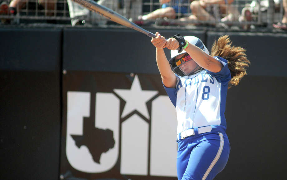 Barbers Hill senior first baseman Courtney Fisher drives a ball in the bottom of the 6th inning against Ennis during their Class 4A semifinal matchup at the 2014 UIL Softball State Championsips at McCombs Field in Austin on Friday. Photo: Jerry Baker, For The Chronicle