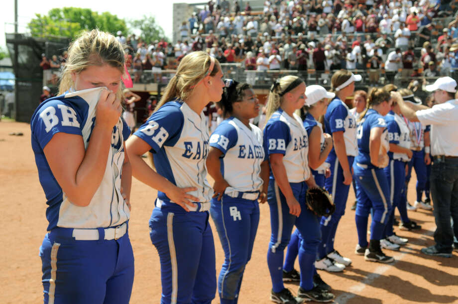 Barbers Hill senior pitcher Randi Rupp, left, and her Eagle teammates accept their medals after losing to Ennis 8-7 in their Class 4A semifinal matchup at the 2014 UIL Softball State Championsips at McCombs Field in Austin on Friday. Photo: Jerry Baker, For The Chronicle