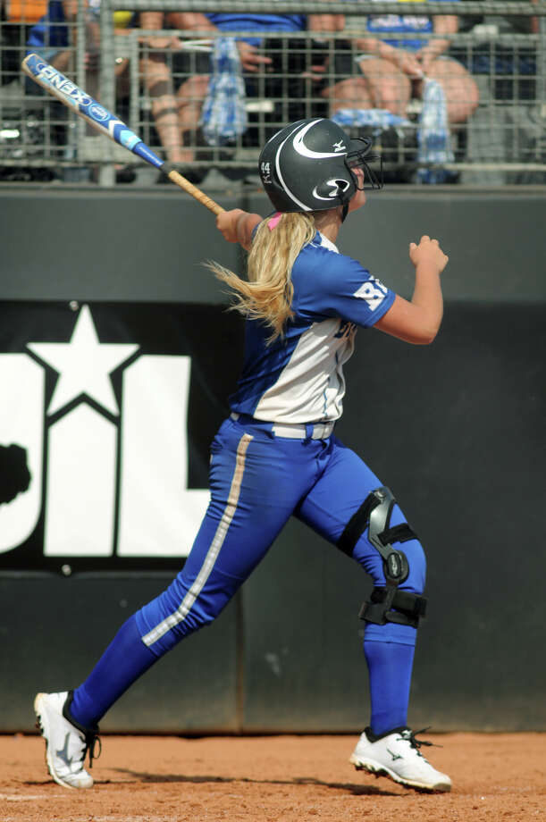 Barbers Hill senior pitcher Randi Rupp follows her homerun in the bottom of the 2nd inning against Ennis in their Class 4A semifinal matchup at the 2014 UIL Softball State Championsips at McCombs Field in Austin on Friday. Photo: Jerry Baker, For The Chronicle