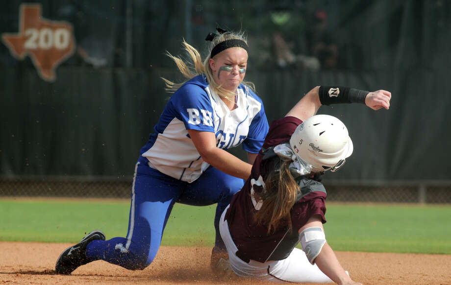 Barbers Hill senior second baseman Erin Houthoofd, left, tries to make a play on Ennis baserunner Julia Hollingsworth in the top of the third inning in their Class 4A semifinal matchup at the 2014 UIL Softball State Championsips at McCombs Field in Austin on Friday. Photo: Jerry Baker, For The Chronicle