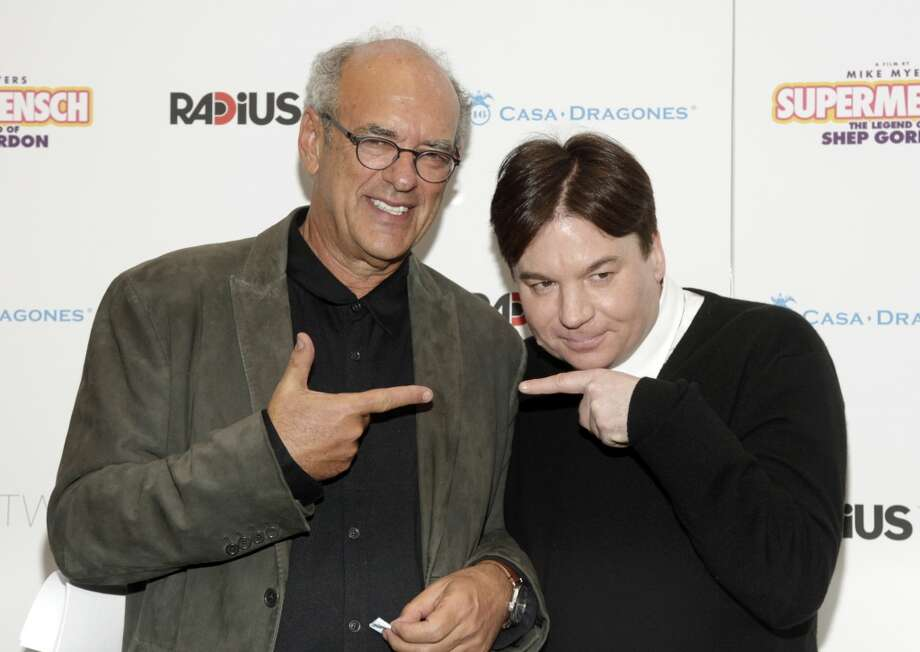 "Talent manager Shep Gordon, left, and actor and director Mike Myers, right, attend a screening of ""Supermensch: The Legend of Shep Gordon"" on Thursday, May 29, 2014, in New York. Photo: Andy Kropa, Associated Press"