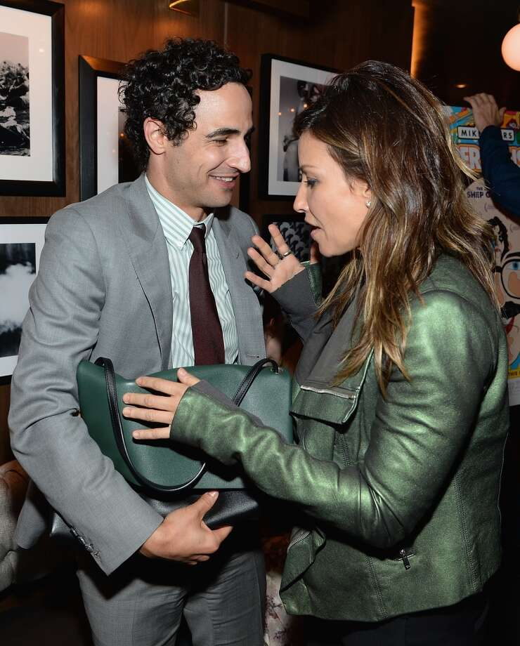 "Zac Posen and Gina Gershon attend the ""Supermensch: The Legend Of Shep Gordon"" screening at The Wayfarer on May 29, 2014 in New York City. Photo: Dimitrios Kambouris, Getty Images"