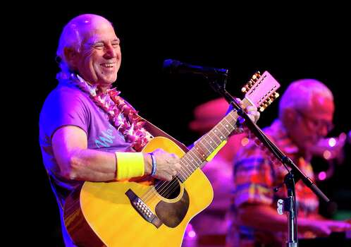 May 28Jimmy Buffett and the Coral Reefer: This legendary act performs at the Cynthia Woods Mitchell Pavilion in The Woodlands. Photo: Jason Fochtman, Associated Press / Conroe Courier