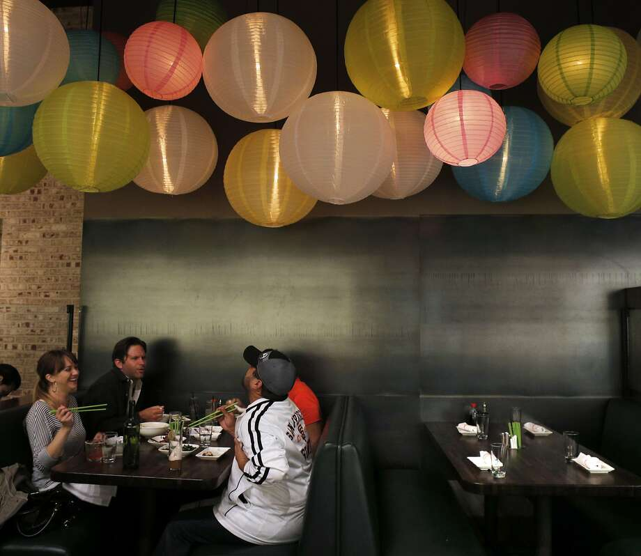 Diners survey the decor at Chino, the newly opened restaurant from the Tacolicious team. Photo: Carlos Avila Gonzalez, The Chronicle