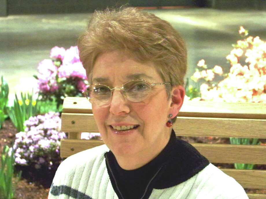 Brookfield resident Lorraine Ballato is passionate about organic gardening. An advanced master gardener, she's also a writer, speaker and author. She shares some great tips in her book, ìSuccessful Self-Watering Containers: Converting Your Favorite Container to a Self-Waterer.î The garden  she and her husband created has been the subject of magazine articles and has been on several garden tours. Photo: Contributed Photo / The News-Times Contributed