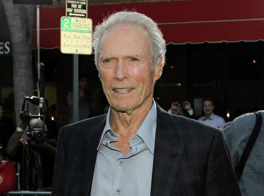 "FILE - This Sept. 19, 2012 file photo shows actor-director Clint Eastwood at the premiere of ""Trouble With the Curve"" at the Westwood Village Theater in Los Angeles. In a wide-ranging interview Saturday about film directing at the Tribeca Film Festival, Eastwood said he admires the 104-year-old Portuguese director Manoel de Oliveira.  Said Eastwood: AƒAƒA'A'AƒA'A'A""It would be great to be 105 and still making films.AƒAƒA'A'AƒA'A'A"" He laughed and called such a hope AƒAƒA'A'AƒA'A'A""the ultimate optimism.AƒAƒA'A'AƒA'A'A""  The director joined fellow filmmaker Darren Aronofsky for a staged conversation at the New York film festival following a screening of Richard Schickel's documentary: AƒAƒA'A'AƒA'A'A""Eastwood Directs: The Untold Story.AƒAƒA'A'AƒA'A'A""  (Photo by Matt Sayles/Invision/AP, file) Photo: Matt Sayles / Invision"