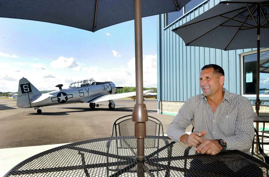 Chris Orofici, owner of Westconn Aviation at Danbury Airport, sits in the area that he hopes will be for outdoor dining in a restaurant he hopes to open at the airport in Danbury, Conn. Friday, May 30, 2014. Photo: Carol Kaliff / The News-Times