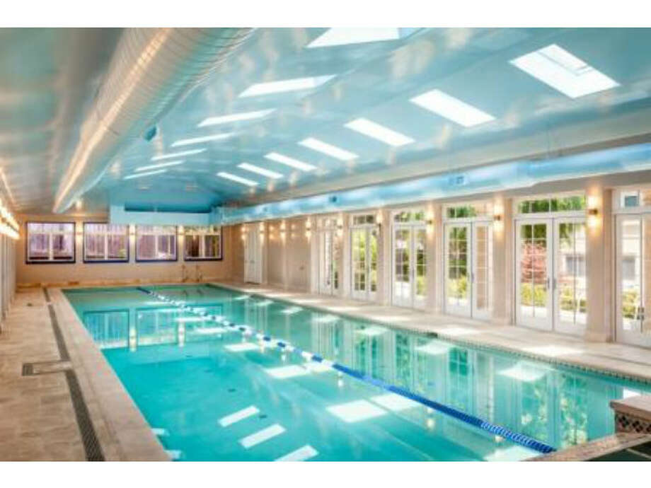 Luxury amenities include a giant indoor pool, a steam room and a four-car garage. Photo: MLS