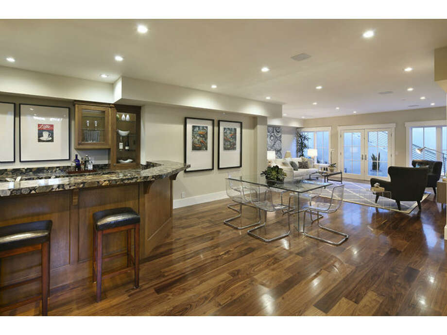 The bottom floor is the perfect entertaining space, with a a bar, recreation room and wine cellar. Photo: MLS
