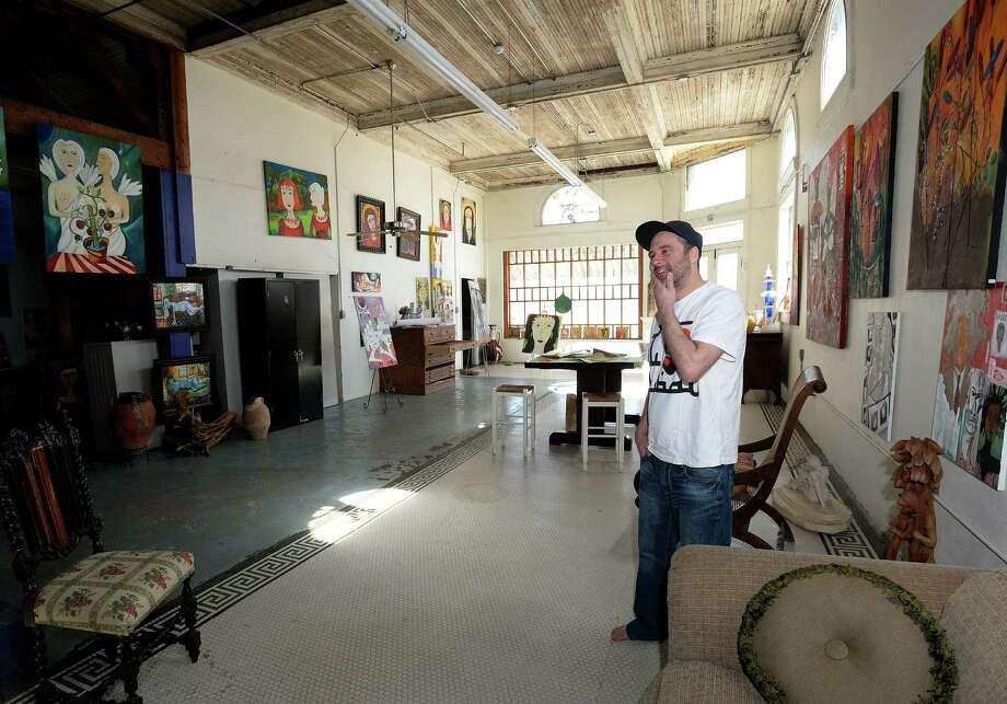 Brandon Bates looks around his father's work studio in downtown Orange. Photo taken Thursday March 15, 2014 Guiseppe Barranco/@spotnewsshooter Photo: Guiseppe Barranco, Photo Editor