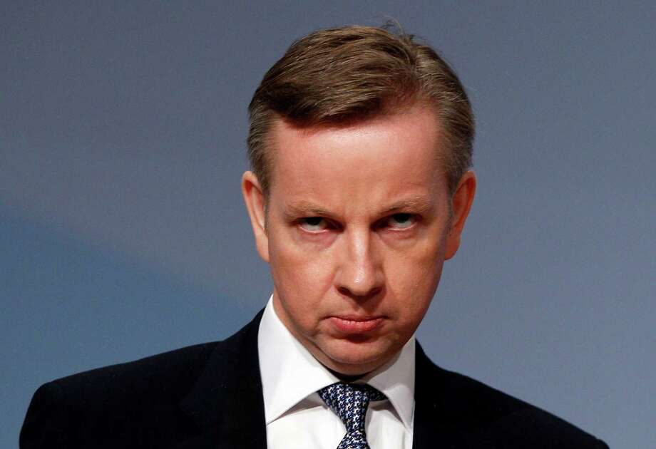"""FILE - In this Tuesday, Oct. 5, 2010 file photo, Britain's Education Secretary Michael Gove listens to applause after delivering a keynote speech at the Conservative party conference in Birmingham, England. Britain's education minister insists he has not killed a mockingbird, but many literature-lovers don't believe him. Education Secretary Michael Gove has sparked a furor with his campaign to put the basics - and Britishness - back into schools. The latest new rules introduced by his department mean that a major English Literature qualification must focus almost exclusively on writers from the British Isles. Longtime favorites like John Steinbeck's """"Of Mice and Men"""" and Harper Lee's """"To Kill a Mockingbird"""" are off the syllabus - and critics say that could lead to the narrowing of British minds. (AP Photo/Kirsty Wigglesworth, file) Photo: Kirsty Wigglesworth, STF / AP"""