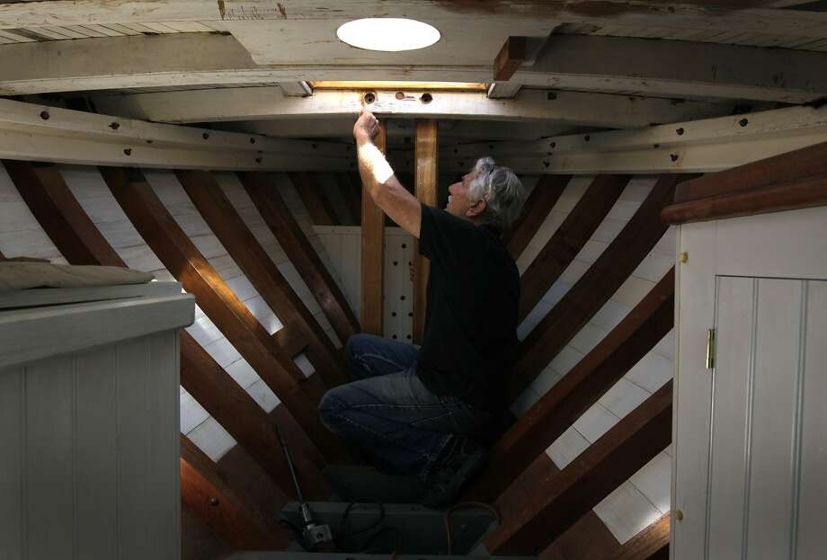 Project manager Bob Darr works on the historic Freda at the Spaulding Wooden Boat Center in Sausalito. Photo: Paul Chinn, The Chronicle