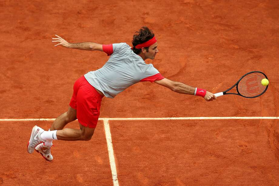 Roger Federer dropped a set for the first time in this year's French Open, but rallied to beat Dmitry Tursunov. Photo: Matthew Stockman, Getty Images