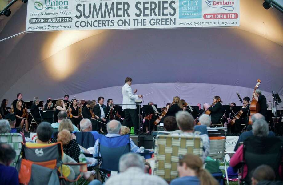Music lovers can take in a summer concert on the Danbury Green Friday and Saturday.  Concerts beging with local groups at 7 p.m. followed by the headliners at 8 p.m. Photo: Scott Mullin, ST / The News-Times Freelance