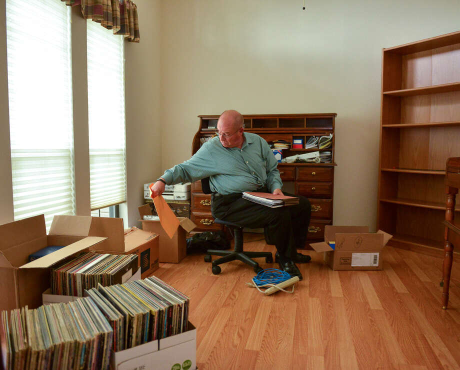 Steve Rehwaldt  sorts items in his home, which sold quickly after it was put on the market. Photo: Robin Jerstad / For The Express-News