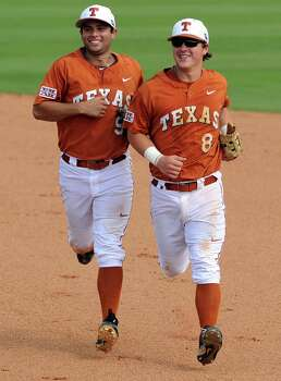 After a diving catch of Texas A&M's Jace Statum's line drive, Texas second baseman Brooks Marlow runs of the field with teammate C.J. Hinojosa during the fourth inning of a Houston NCAA baseball regional game, Friday, May 30, 2014, at Reckling Park in Houston. Photo: Eric Christian Smith, For The Chronicle