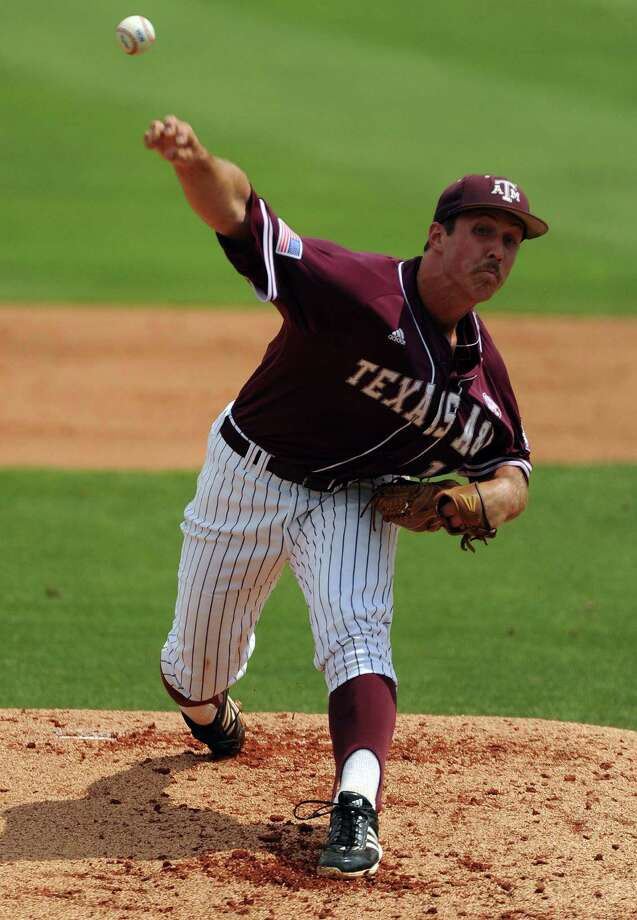 Texas A&M's Daniel Mengden delivers a pitch during the first inning of the Houston NCAA baseball regional against Texas, Friday, May 30, 2014, at Reckling Park in Houston. Photo: Eric Christian Smith, For The Chronicle