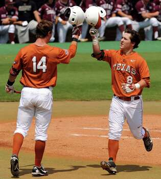 Texas' Brooks Marlow, right, celebrates his solo home run with Ben Johnson during the first inning of a Houston NCAA baseball regional game against Texas A&M, Friday, May 30, 2014, at Reckling Park in Houston. Photo: Eric Christian Smith, For The Chronicle