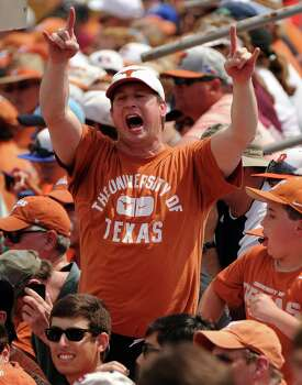 A fan of the Texas Longhorns cheers Brooks Marlow's solo home run during the first  inning of a Houston NCAA baseball regional game against Texas A&M, Friday, May 30, 2014, at Reckling Park in Houston. Photo: Eric Christian Smith, For The Chronicle