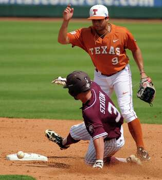 Texas A&M's Jace Statum, left, is touched by the ball for an out during a force as Texas' C.J. Hinojosa looks on during the second inning of a Houston NCAA baseball regional game, Friday, May 30, 2014, at Reckling Park in Houston. Photo: Eric Christian Smith, For The Chronicle