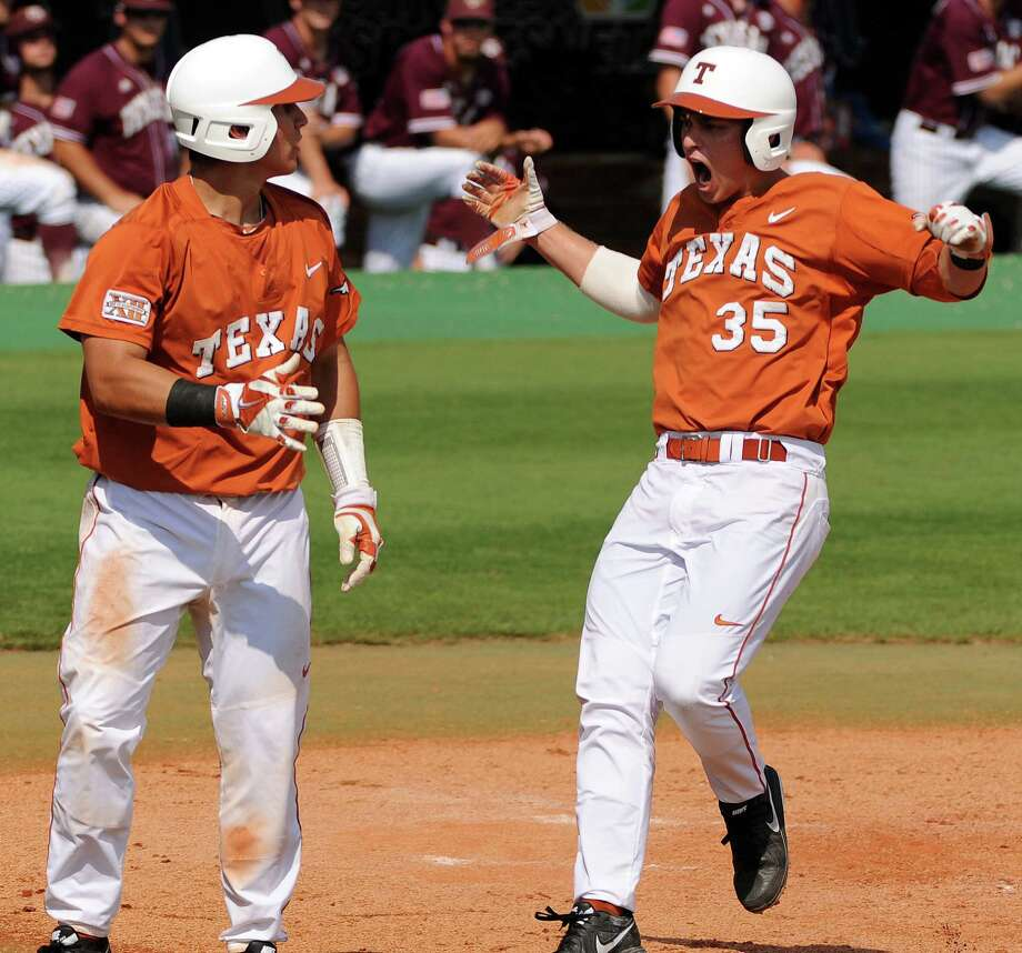 Texas' Madison Carter, right, celebrates his run scored with Tres Barrera during the third inning of a Houston NCAA baseball regional game against Texas A&M, Friday, May 30, 2014, at Reckling Park in Houston. Photo: Eric Christian Smith, For The Chronicle