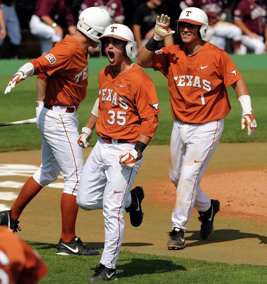 Texas' Madison Carter, center, celebrates his run scored during the third inning of a Houston NCAA baseball regional game against Texas A&M, Friday, May 30, 2014, at Reckling Park in Houston. Photo: Eric Christian Smith, For The Chronicle