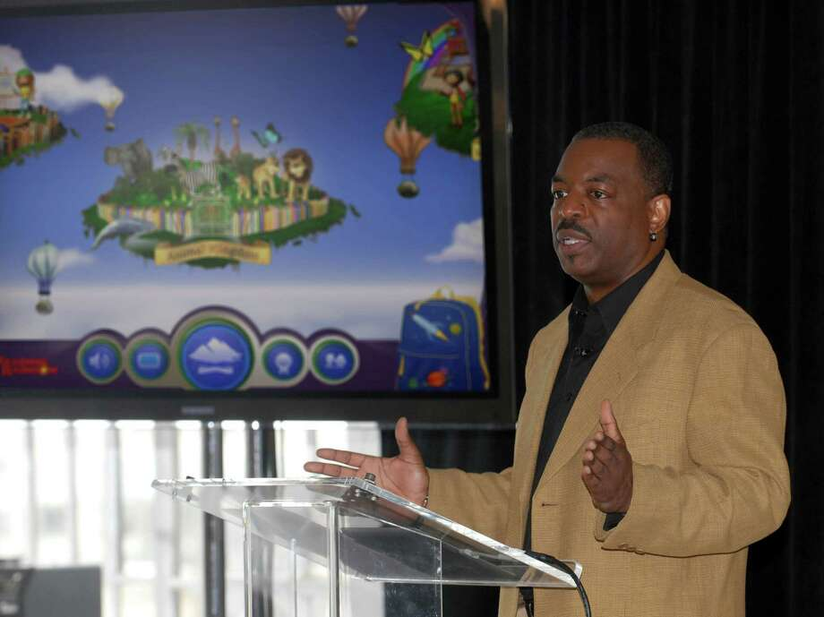 "FILE- This June 19, 2012 file photo shows LeVar Burton introducing the all new Reading Rainbow adventure app to the media, publishers and parents at the ""Reading Rainbow Relaunch"" event in New York.  Burton's campaign to bring ""Reading Rainbow"" to the online masses is off to an impressive start. It reached its fundraising goal within hours of its launch on Wednesday, May 28, 2014, on Kickstarter, according to the fundraising website. (AP Photo/Reading Rainbow, file) Photo: Uncredited, Associated Press / Reading Rainbow"