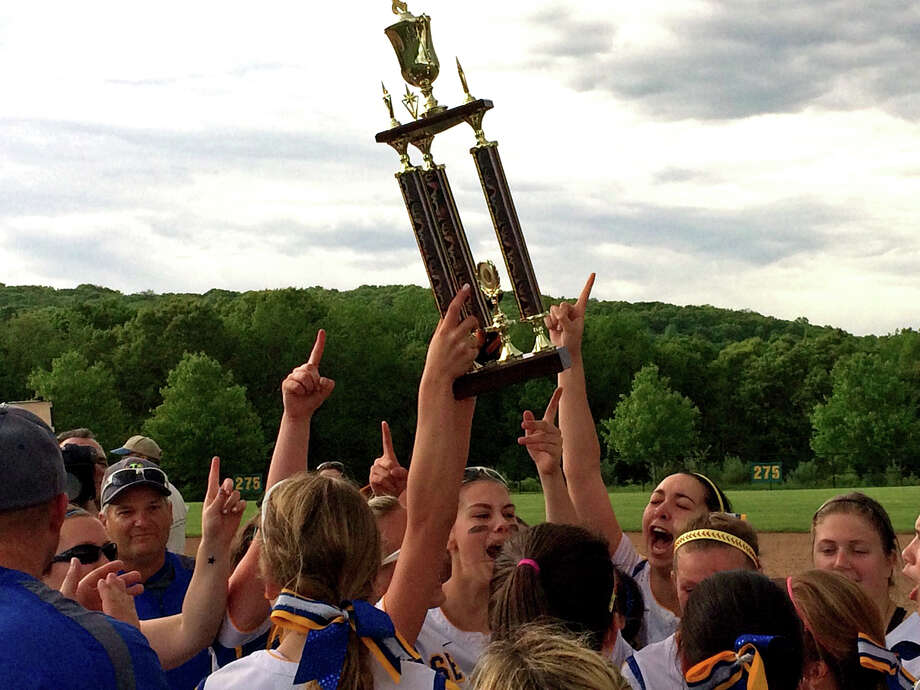 The Seymour High School softball team celebrates their victory over Torrington in the Naugatuck Valley League championship on Friday, May 30, 2014. Photo: Contributed Photo, Jennifer Hoffer / Connecticut Post Contributed