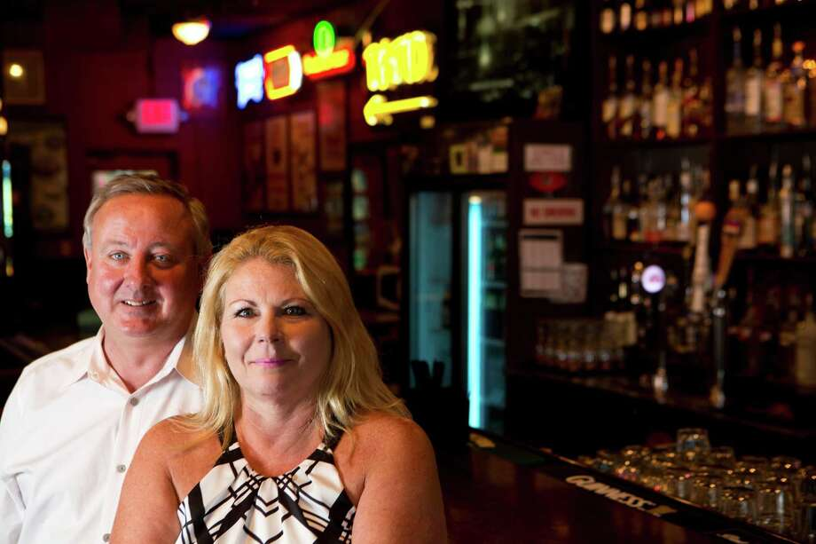 Max McElroy and his wife Valerie McElroy will be closing The State Bar and Lounge Saturday, May 31, 2014, after owning it for 16 years. The State Bar and Lounge is located on the second floor of the Rice Lofts. Friday, May 30, 2014, in Houston. ( Marie D. De Jesus / Houston Chronicle ) Photo: Marie D. De Jesus, Staff / © 2014 Houston Chronicle