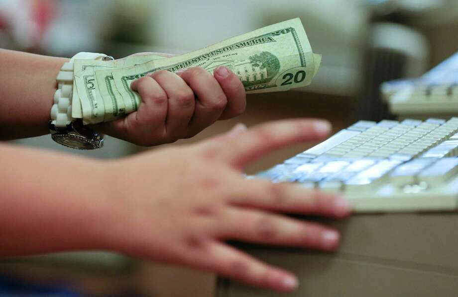 Before you head to the grocery store cash register with a fistful of coupons, here is a rundown of local retail rules. Photo: Julie Jacobson / AP