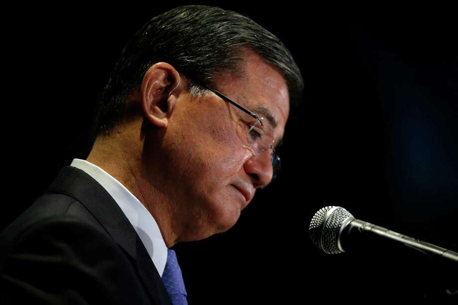 "Veterans Affairs Secretary Eric Shinseki pauses while speaking at a meeting of the National Coalition for Homeless Veterans, Friday, May 30, 2014, in Washington. President Barack Obama says he plans to have a ""serious conversation"" with Shinseki about whether he can stay in his job. Photo: Charles Dharapak, AP / AP"