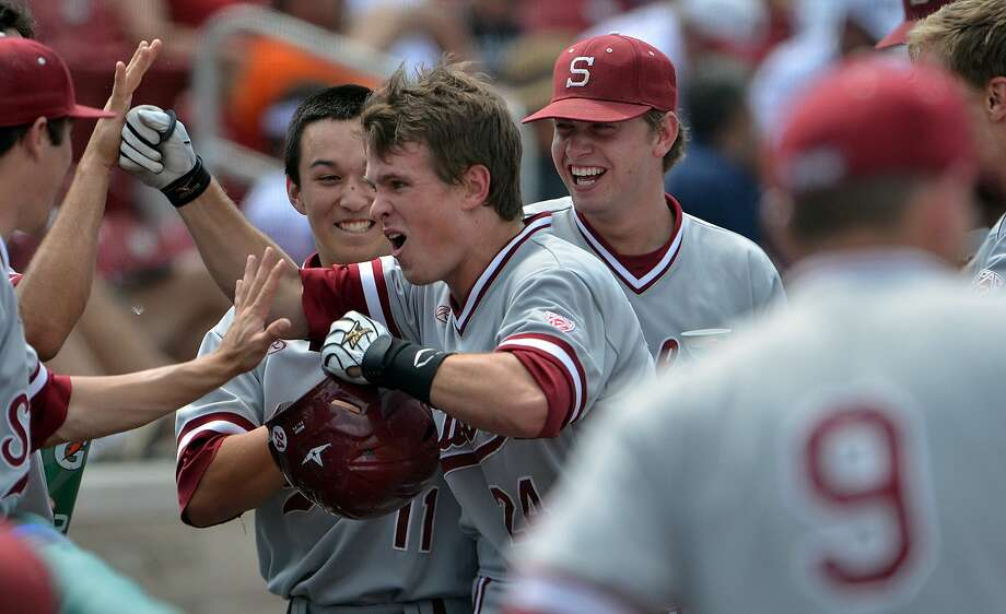 Stanford's Jack Klein is greeted after his first collegiate homer. It was a three-run shot in the sixth inning. Photo: Joseph C. Garza, Associated Press