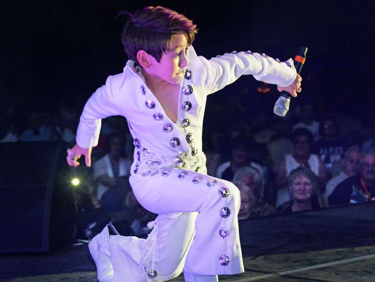 Nine-year-old Connor Russo of Caledon, Ontario, performs in the youth division at the first round of Elvis tribute artist competition at the Lake George Forum Friday May 30, 2014, in Lake George, NY. (John Carl D'Annibale / Times Union)