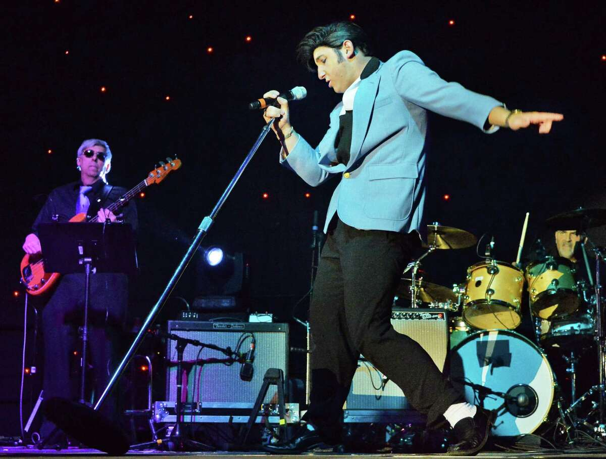 Nick Mischissin of Drums, Penn., performs in the first round of Elvis tribute artist competition at the Lake George Forum Friday May 30, 2014, in Lake George, NY. (John Carl D'Annibale / Times Union)