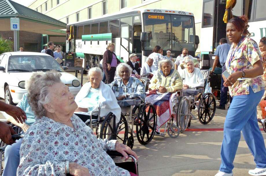 Elderly wheelchair-bound citizens from the Edgewater Retirement Community in Galveston are seen as they prepare to board a bus to evacuate the city ahead of Hurricane Rita. The chaotic evacuation before  Rita proved deadlier than the storm itself, and led to improvements in evacuation plans, routes and reversible freeway lanes.     REUTERS/Tim Johnson Photo: TIM JOHNSON, STR / X01803