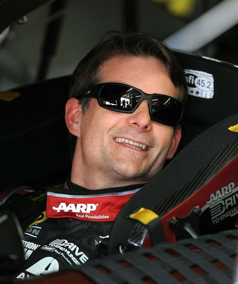 NASCAR Sprint Cup Series driver Jeff Gordon laughs with the crew as he prepares for practice at Charlotte Motor Speedway in Concord, N.C., on Saturday, May 24, 2014. Back spasms forced Gordon to cut short his practice session ahead of Sunday's Coca-Cola 600. (Jeff Siner/Charlotte Observer/MCT) Photo: Jeff Siner, McClatchy-Tribune News Service