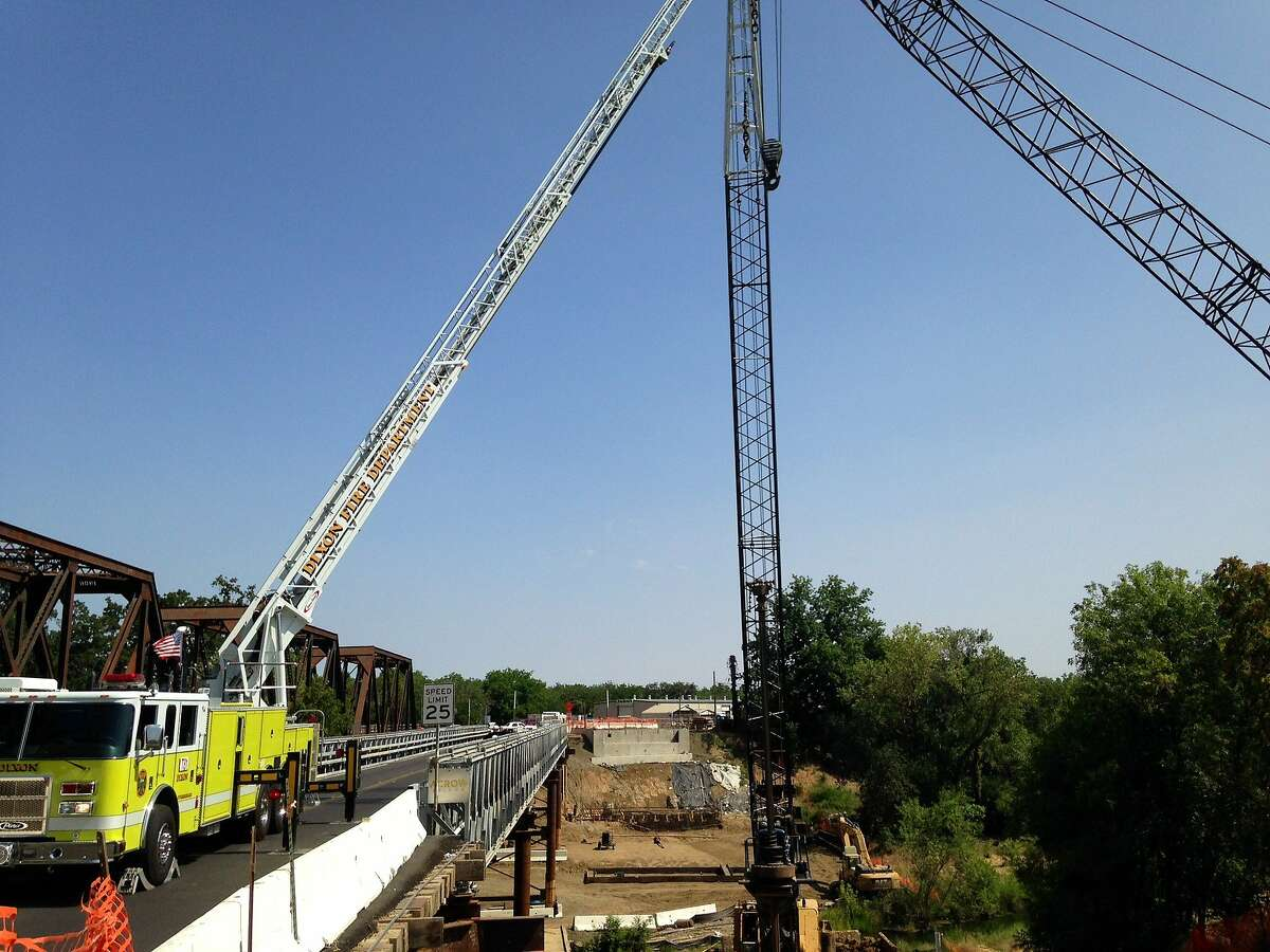 Two construction workers fell 80 feet from the yellow basket of this crane and died early on Friday, May 30, 2014, in Winters (Yolo County).