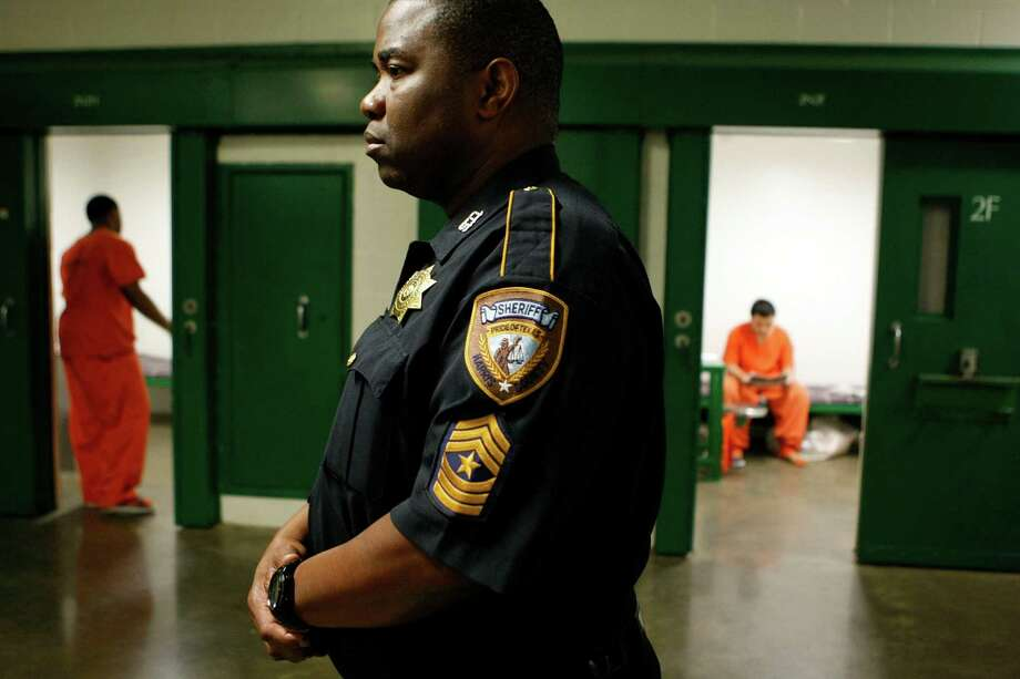 Sgt. Roosevelt Berry looks on as two16 and under juveniles who have been charged as adults for crimes ranging from Class B misdemeanors to capitol murder spend their time at the Harris County Jail on 1200 Baker St. Friday, May 11, 2012, in Houston. 