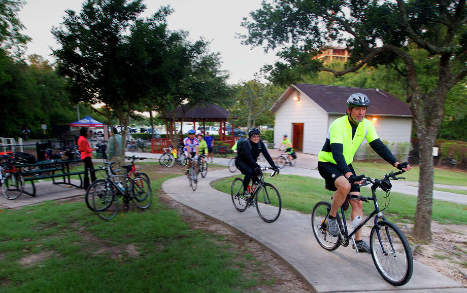 Cyclists enter Terry Hershey Park as the Energy Corridor District hosts Bike To Work Day, Thursday, May 15, 2014, in Houston. Bike To Work Day takes place during May, which is national Bike To Work month, and aims to introduce bike commuting to new riders and also recognizes regular basis commuters. (Cody Duty / Houston Chronicle) Photo: Cody Duty, Staff / © 2014 Houston Chronicle