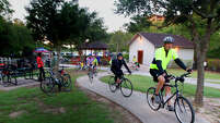Cyclists enter Terry Hershey Park as the Energy Corridor District hosts Bike To Work Day, Thursday, May 15, 2014, in Houston. Bike To Work Day takes place during May, which is national Bike To Work month, and aims to introduce bike commuting to new riders and also recognizes regular basis commuters. (Cody Duty / Houston Chronicle)