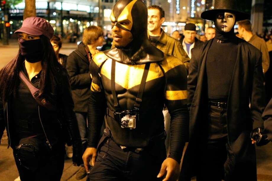 "Phoenix Jones and his posse of Seattle superheroes make an appearance at the Occupy Seattle protests at Westlake Park in October 2011. Phoenix Jones said that he understands why they are protesting, but added, ""Getting arrested sucks. Believe me I know."" Photo: JOE DYER, Seattlepi.com File"