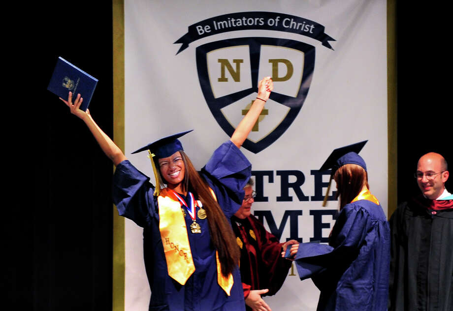 Graduate Jasmine Fuller celebrates getting her diploma, during Notre Dame of Fairfield's Class of 2014 Commencement Exercises in Fairfield, Conn. on Friday May 30, 2014. Photo: Christian Abraham / Connecticut Post