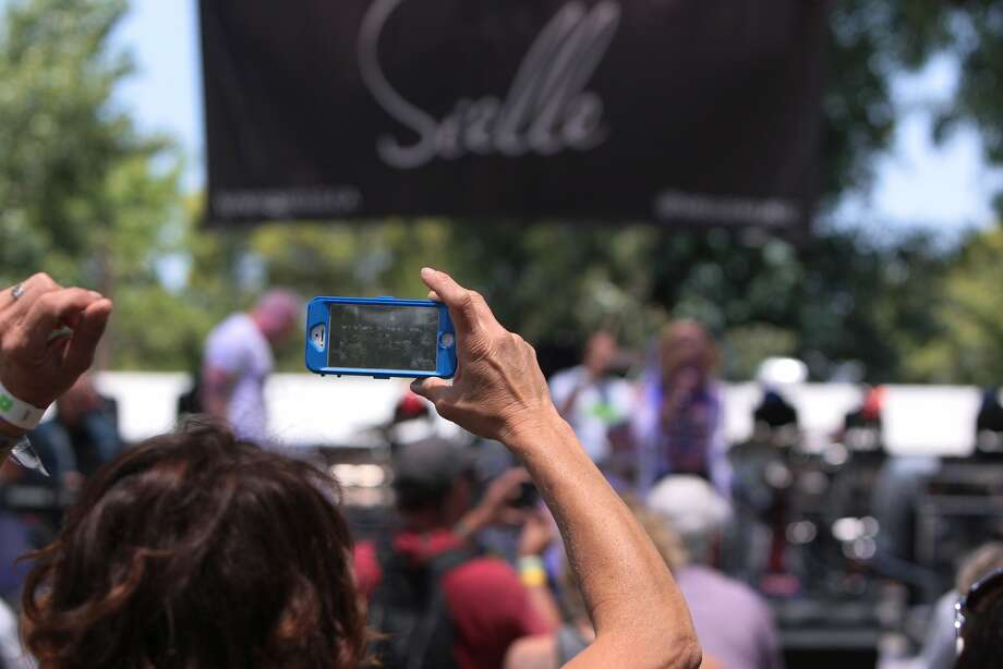 A fan takes video during Sielle's set at the 2014 Bottlerock Napa Valley music, food and wine festival on Friday, May 30, 2014 in Napa, Calif. Photo: Kevin N. Hume, The Chronicle