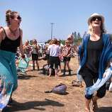 Hayley Colley and Guinevere King of San Diego dance during Moon Taxi at the 2014 Bottlerock Napa Valley music, food and wine festival on Friday, May 30, 2014 in Napa, Calif.