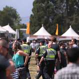 Police patrol around the beer and wine tents at the 2014 Bottlerock Napa Valley music, food and wine festival on Friday, May 30, 2014 in Napa, Calif.